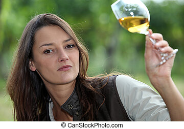 Woman looking glass of wine