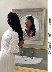 Woman looking in mirror in the morning