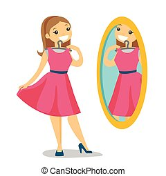 Woman looking in the mirror in the dressing room.