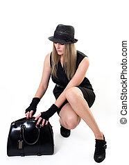 Woman looking into her handbag