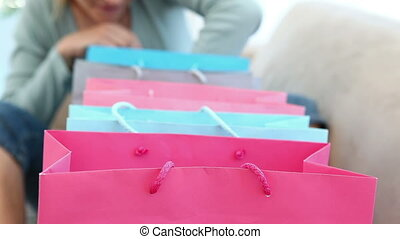 Woman looking into her shopping bags