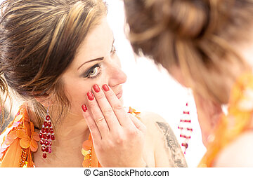 Woman looking into the mirror