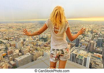 Woman looking Los Angeles Skyline