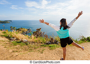 Woman looking ocean views and expressions of joy
