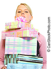 Woman looking out from stack of present boxes