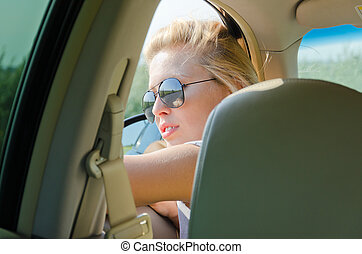 Woman looking out of a car window