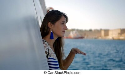 Woman looking out of ship window