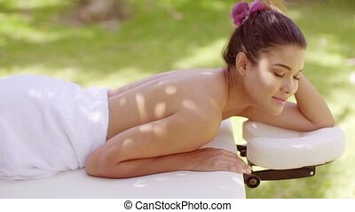 Woman looking over in outdoor beauty spa