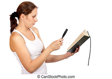 Woman looking papers with magnifying glass