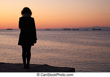 Woman looking the sea, Trieste - Silhouettes of a Woman that...