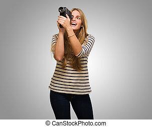 Woman Looking Through A Camera
