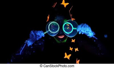 Woman looking through bubbles
