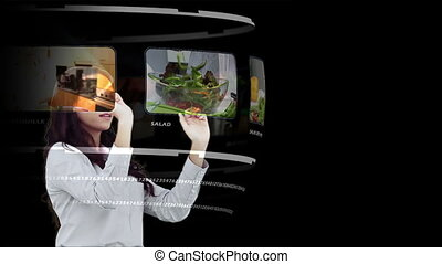 Woman looking through interactive m