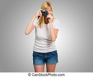 Woman Looking Through Old Camera
