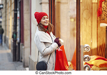 Woman looking through the stores window
