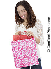 Woman looking to her gift bag