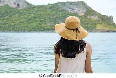 Woman looking towards the sea water