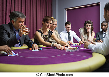 Woman looking up from poker game