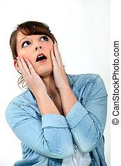 woman looking very surprised