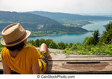 woman looks at Lake Annecy in summer