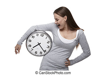 Woman looks at the clock