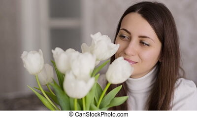 Woman Looks on Tulips
