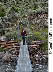 Woman Looks to Side While Standing on Bridge