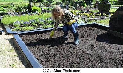 woman loosen grave ground