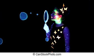 Woman luminous make up playing with bubble