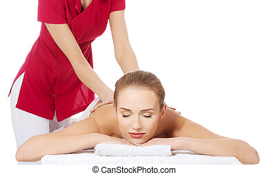 Woman lying and relaxing at spa saloon