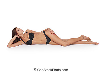 Woman lying down in lingerie - Portrait of a sexy woman...