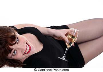 Woman lying down with a glass of champagne