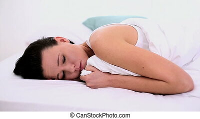 Woman lying in bed exhausted - Thoughtful woman lying...