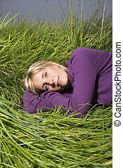 Woman lying in grass.