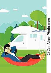 Woman lying in hammock. - An asian woman lying in a hammock ...