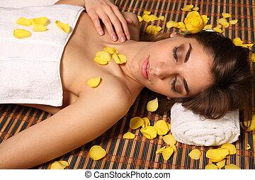 Woman lying in health spa asleep