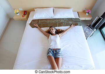Woman lying in hotel room