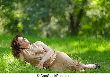 Woman lying in nature