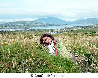 woman lying in th eflowers