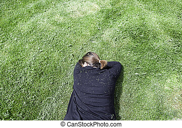 Woman lying in the grass