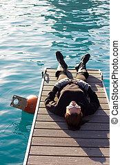 Woman Lying On A Pier