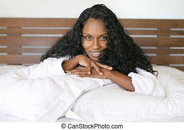 Woman lying on pillows