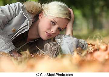 Woman lying on some leaves
