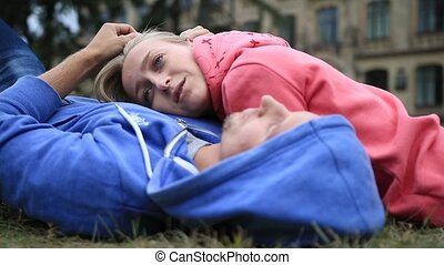 Woman lying on the chest of her beloved outdoors