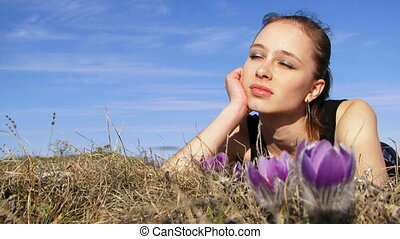 Woman lying on the grass and dreami