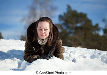 woman lying on the  snow