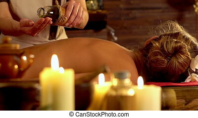Woman lying on wooden massage spa bed. Slow motion. - Young...
