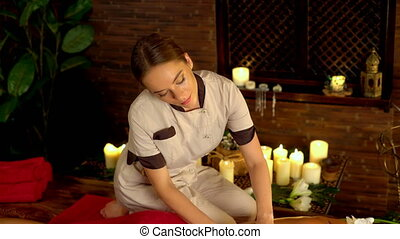 Woman lying on wooden massage spa bed. 4k. - Young woman...