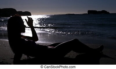 Woman lying under the moonlight on the beach