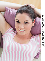 Woman lying while recreating - Relaxing woman lying on the ...